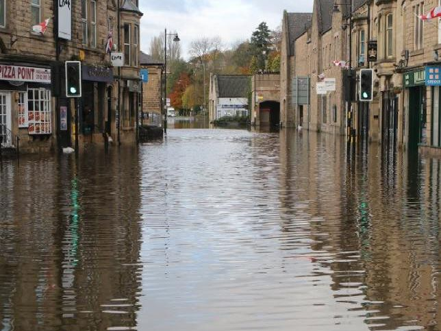 Our photographer Jason Chadwick has captured this devastating flood scene on the usually busy A6 in Matlock town centre.