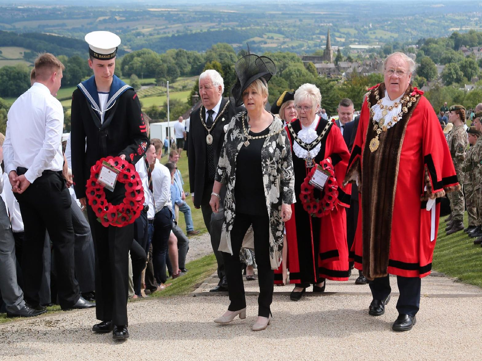 A sea cadet assists the dignitaries up the steps.''Picture: Eric Gregory.