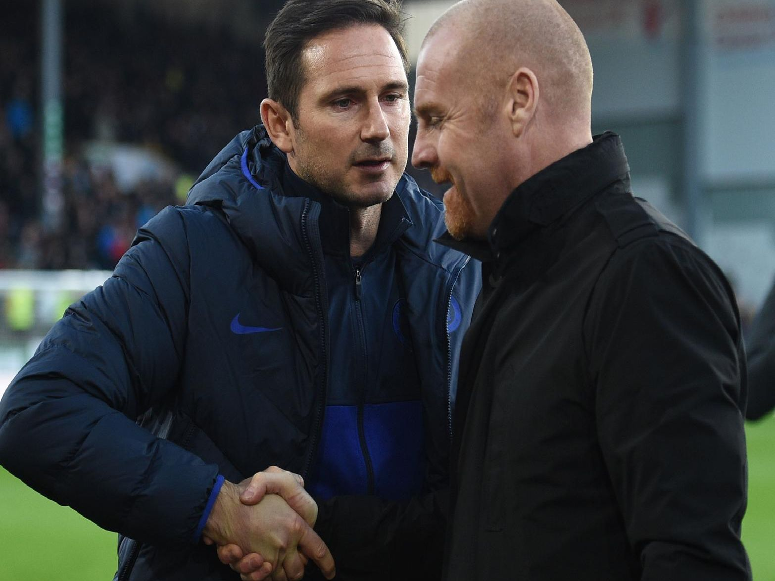 Burnley boss Sean Dyche and Chelsea head coach Frank Lampard shake hands