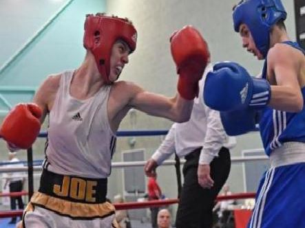 Burnley boxer, Joe Crawford (16) on the left.
