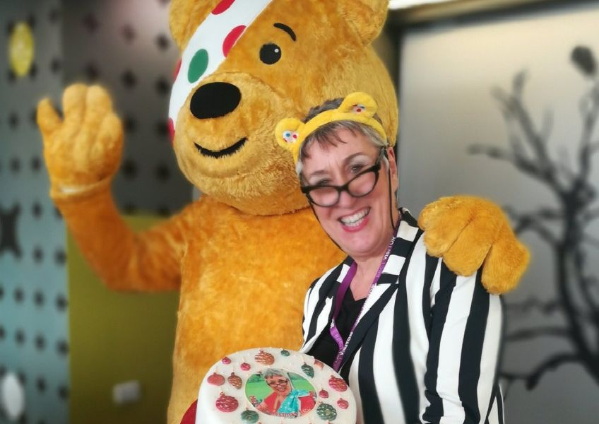 Pontefract's Karen Wright, who shot to fame as a contastant on The Great British Bake Off earlier this year, with Pudsey bear.