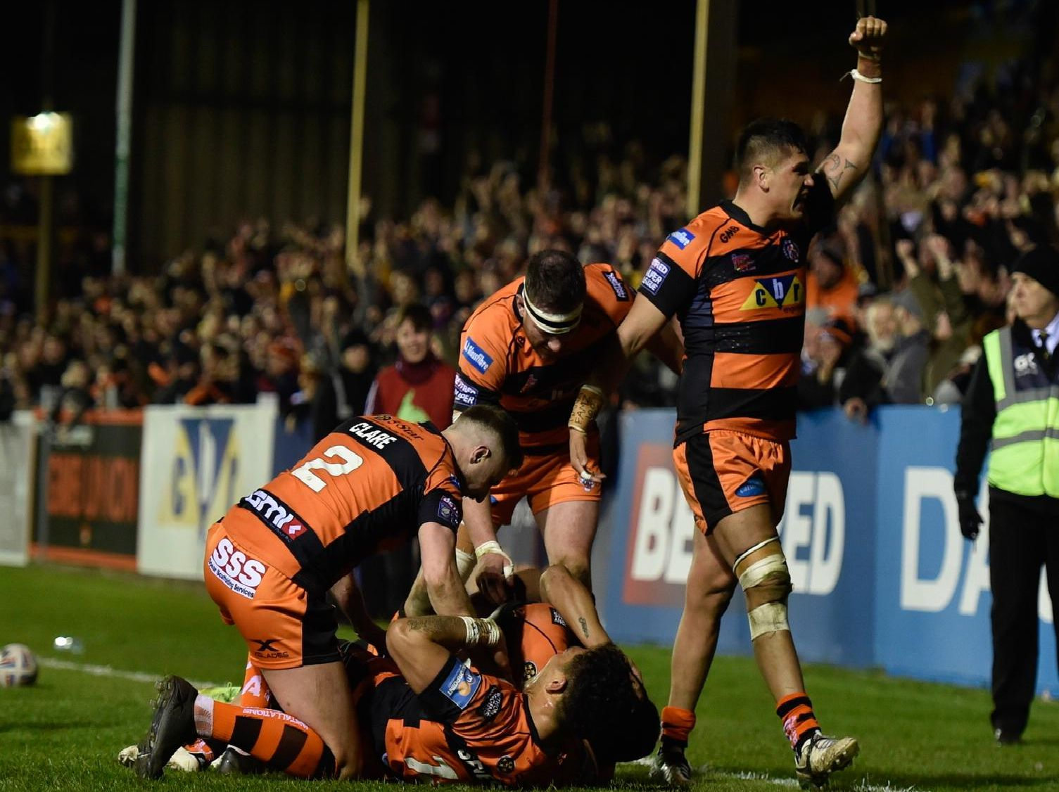 Castleford Tigers players celebrate as Peter Mata'utia goes over for the final try against Wigan. Picture: Matthew Merrick