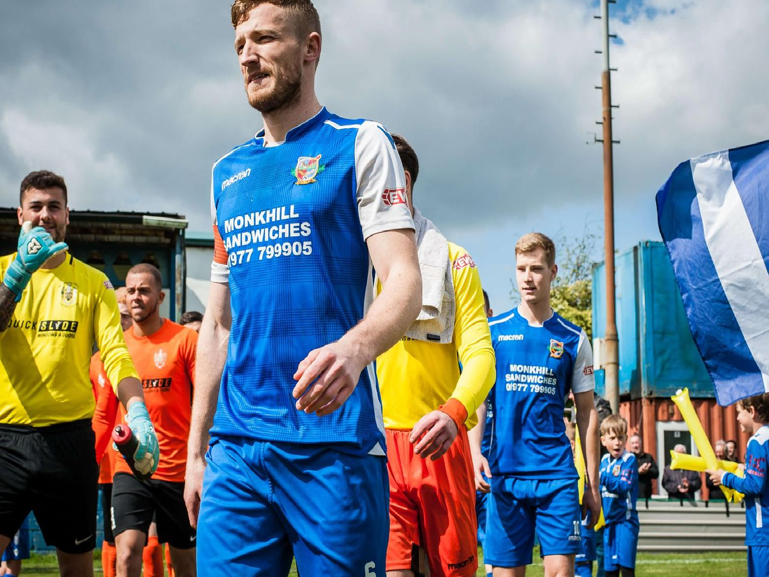 Spencer Clarke leads out his Pontefract Collieries team for the Evo-Stik East Division play-off final. Picture: James Heaton