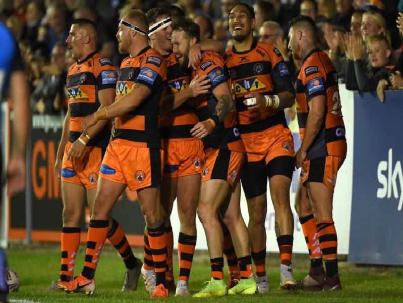 Castleford Tigers player celebrate a well-earned win.