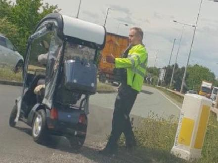 One of the police officers giving advice to the confused man.