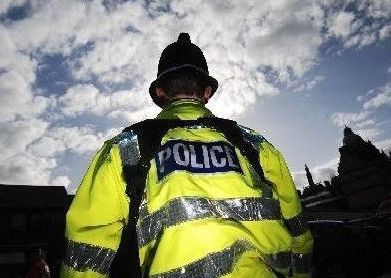 A grieving alcohol-fuelled woman assaulted two police officers during the anniversary of the death of a former partner.