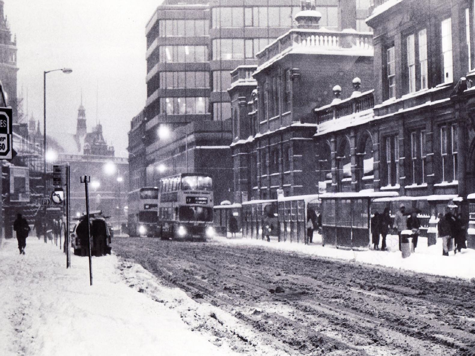 Buses struggle through the snow and slush in Leopold Street in 1986.