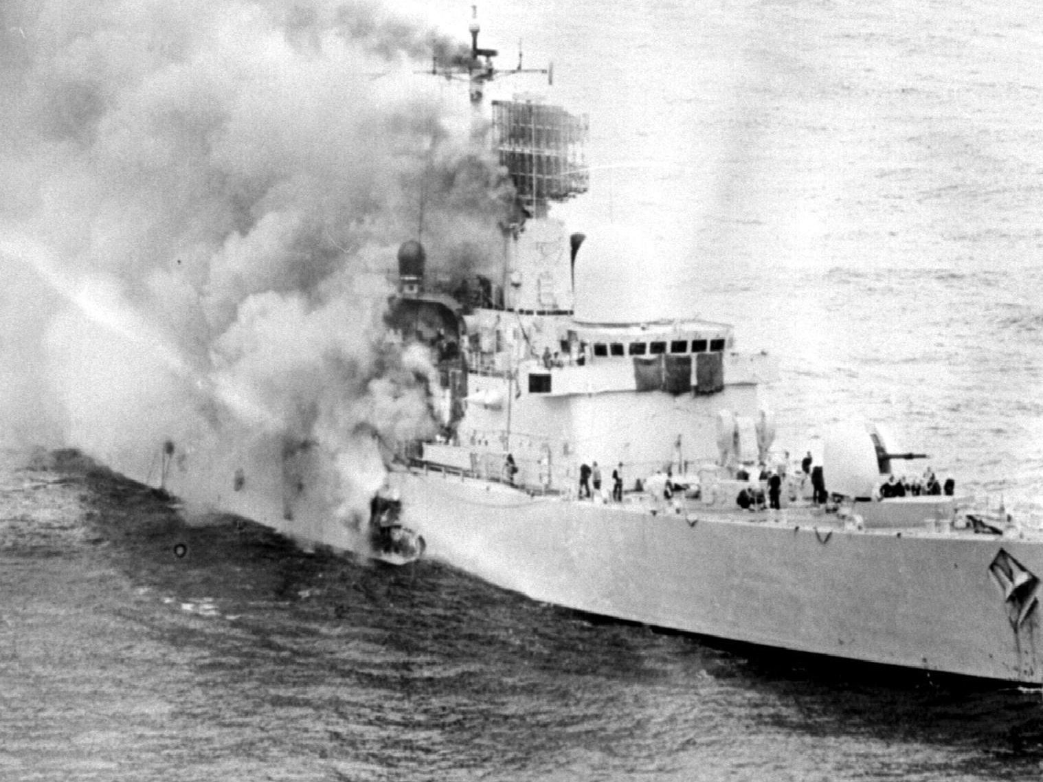 The iconic image of HMS Sheffield ablaze in the South Atlantic.
