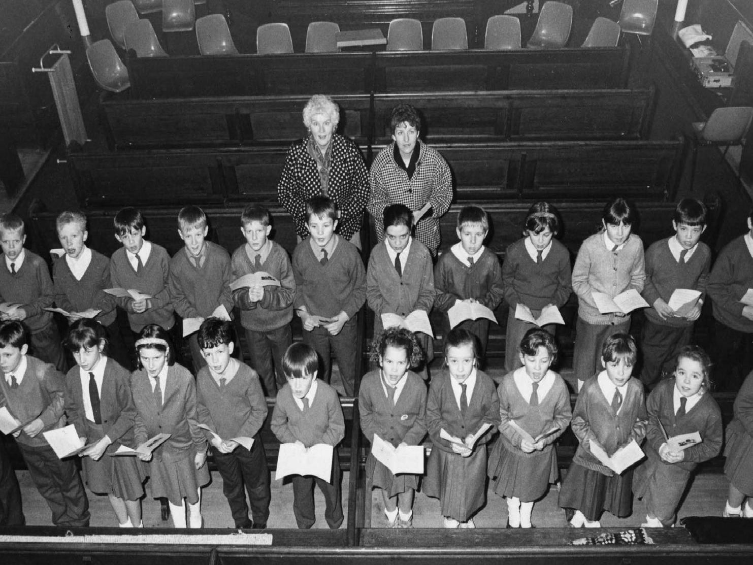 Pupils and staff from St Matthew's Primary School, in Jarrow, prepare for a carol service at Park Road Methodist Church, in Bede Burn Road, in 1991.