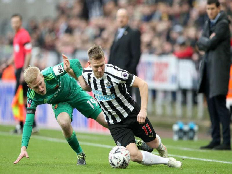 Newcastle's Matt Ritchie challenges for the ball against Watford.