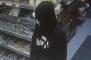 Police investigating a knifepoint robbery at a newsagents in Mirfield have released this CCTV image.