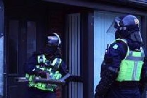 Dawn raids took place in St Helens, Liverpool and Chester