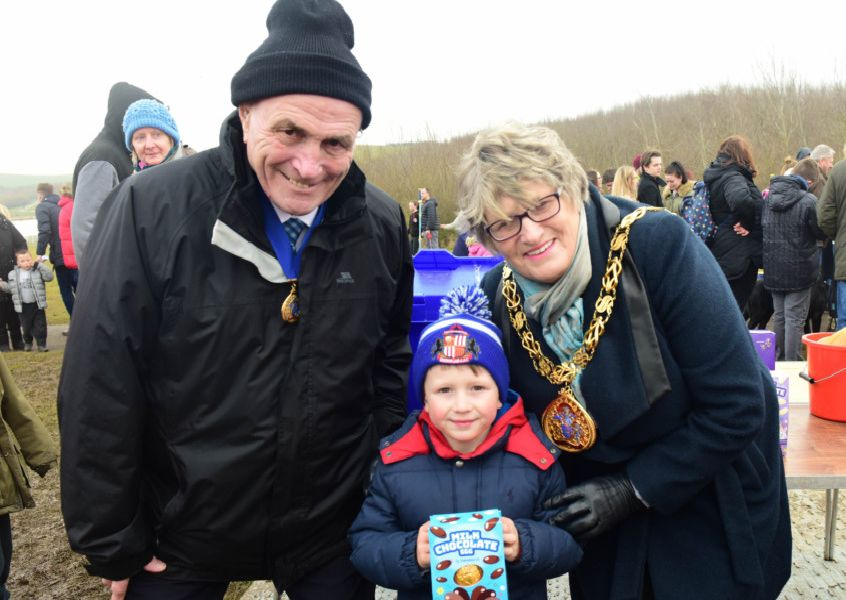 Coun Doris MacKnight with her husband consort Keith with one of the prize winners Blake Carr, 5, of Ashbrooke.
