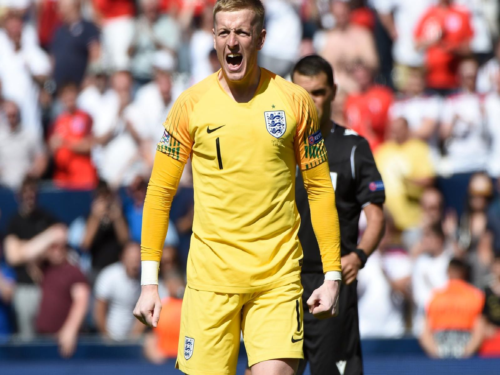 England's goalkeeper Jordan Pickford celebrates a goal during the penalty shootout during the UEFA Nations League third place football match between England and Switzerland