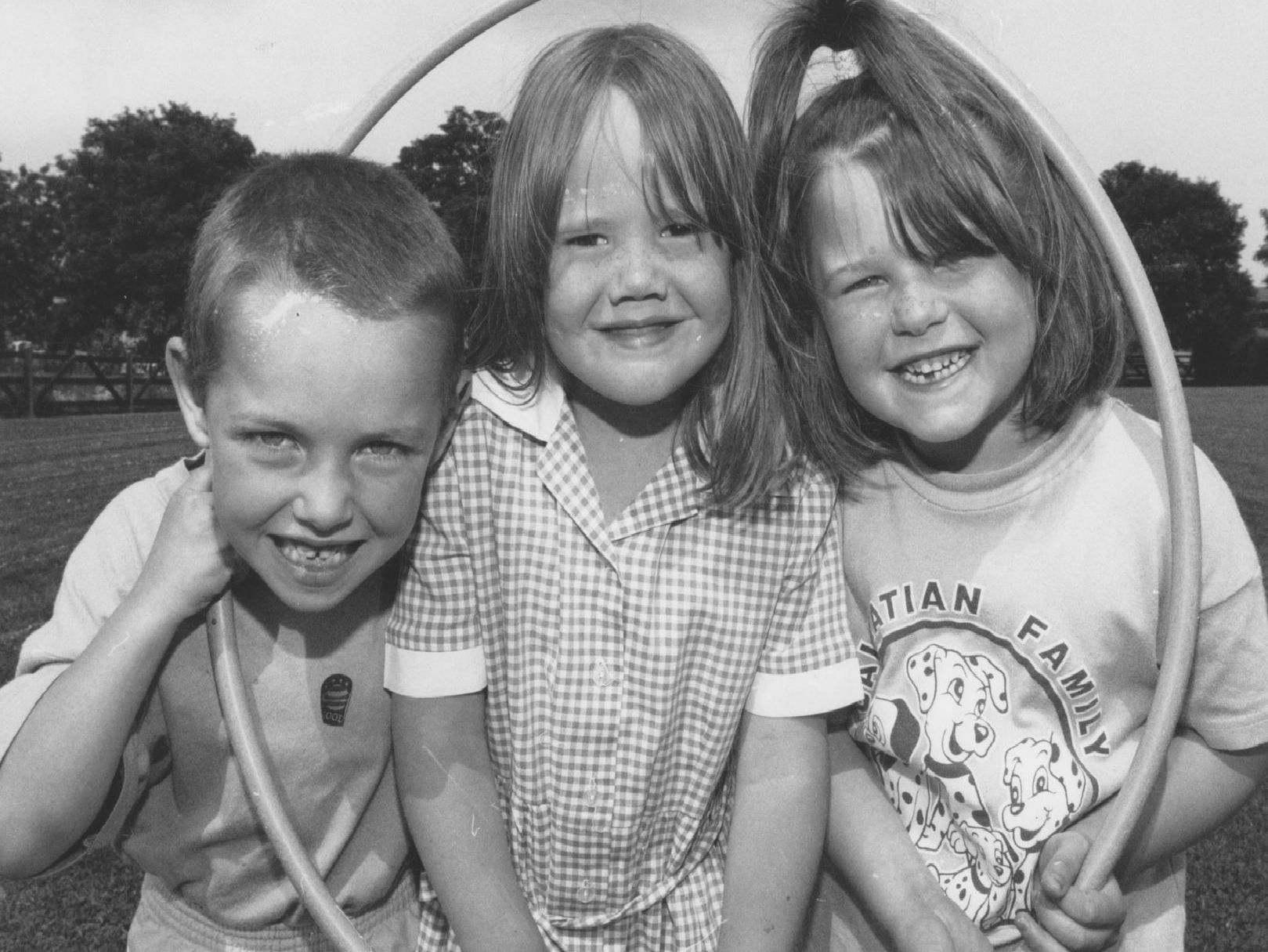 Taking a break from the hoopla at Filey Junior School's Infants Sports Day in July, 1997, are, left to right, Daniel Hudson, Stacey Maud and Zoe Spriggs.