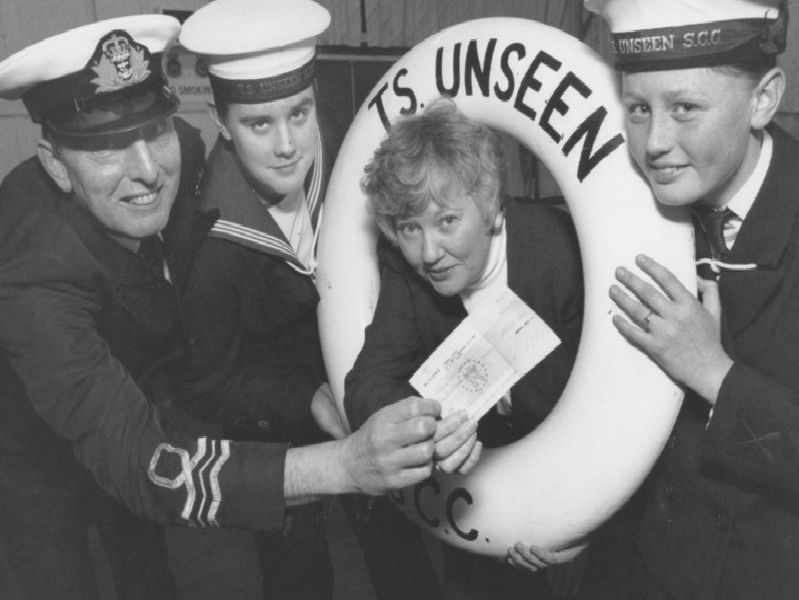 Filey Sea Cadets minibus fund received a 500 boost thanks to a donation from local firm Marshall Bros in January 1997. Marshall Bros director Barbara Liversidge, third left, is pictured presenting the cheque to, from left, Lt Commander Eddie Temple, Leading Seaman Jonathan Taylor, and Able Cadet Caley Pinder.