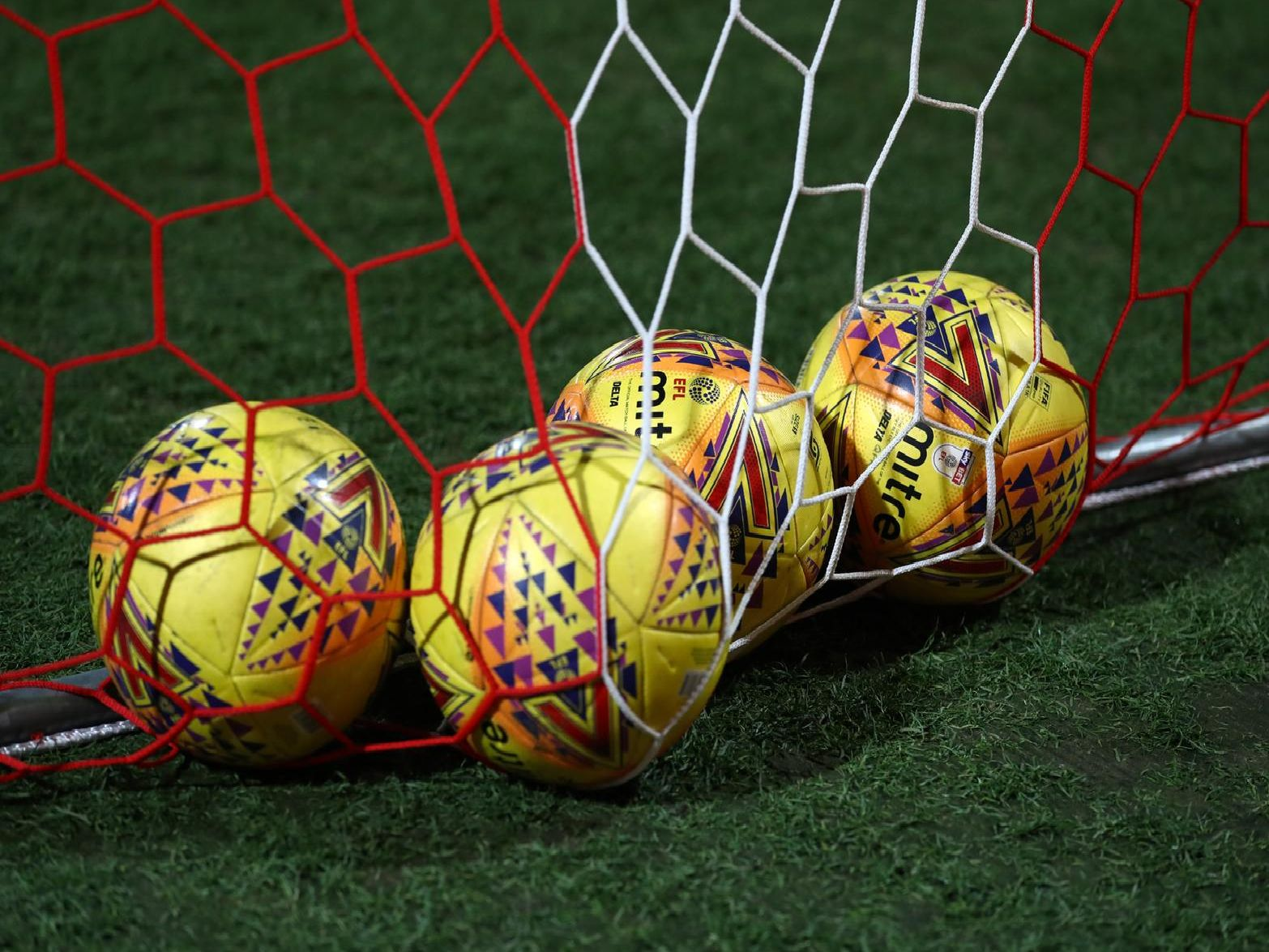 EFL Mitre match balls lie in the goal (Photo by Catherine Ivill/Getty Images)