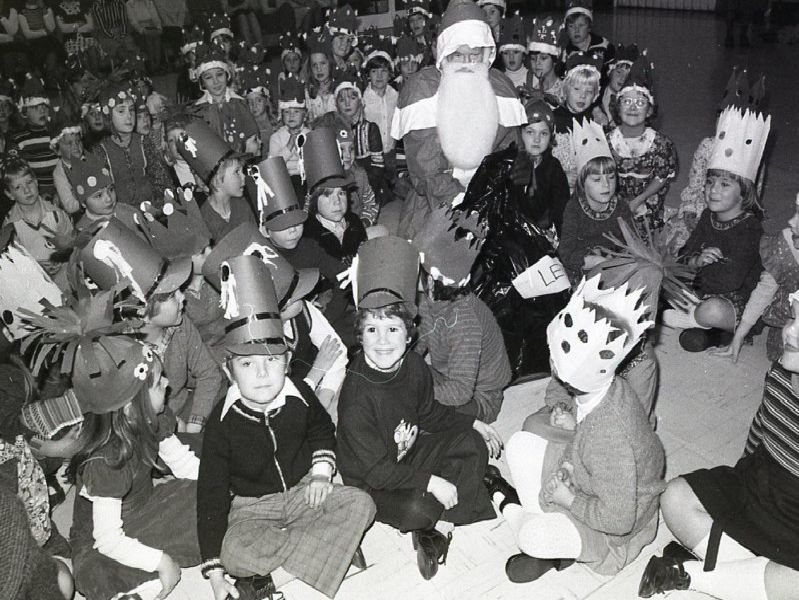 Children at Lever House Primary School, Farington, near Preston, enjoy a visit from Father Christmas during their Christmas party