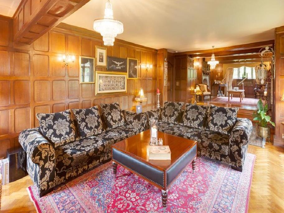 The luxurious wood-panelled lounge of Sugworth Hall, a six bed property at Bradfield Dale on the market for offers in the region of up to 1,650,000 through Blenheim Park Estates on 0114 446 9290.