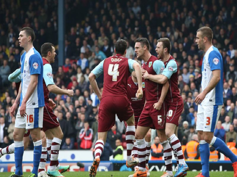 Jason Shackell celebrates his equaliser for Burnley against Blackburn Rovers at Ewood Park in March 2014