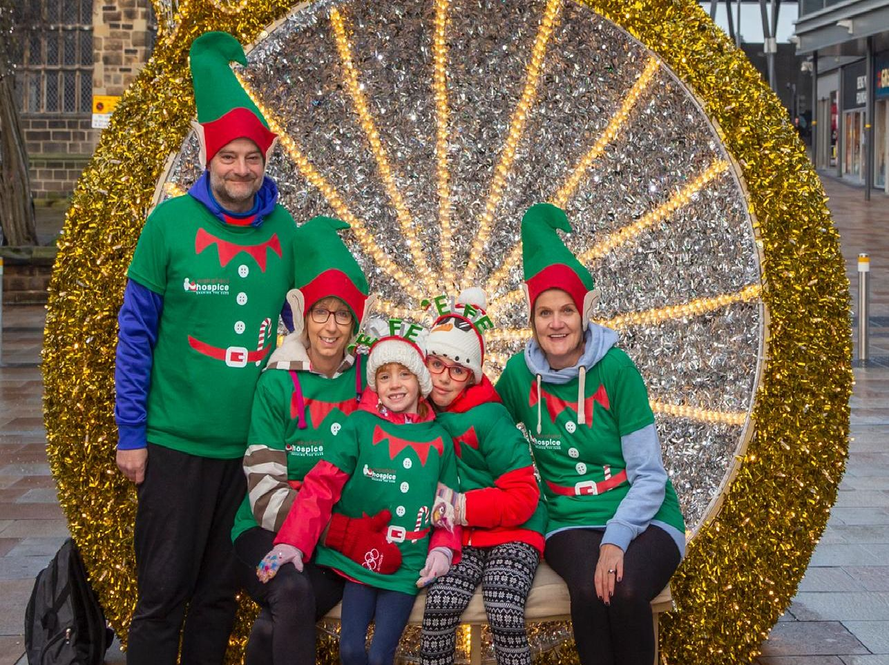 A family of elves smile for our photographer