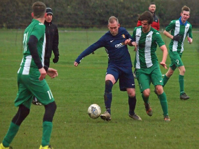 Gary Hepples of Edgehill and Fishburn's Paul Tose battle for the ball