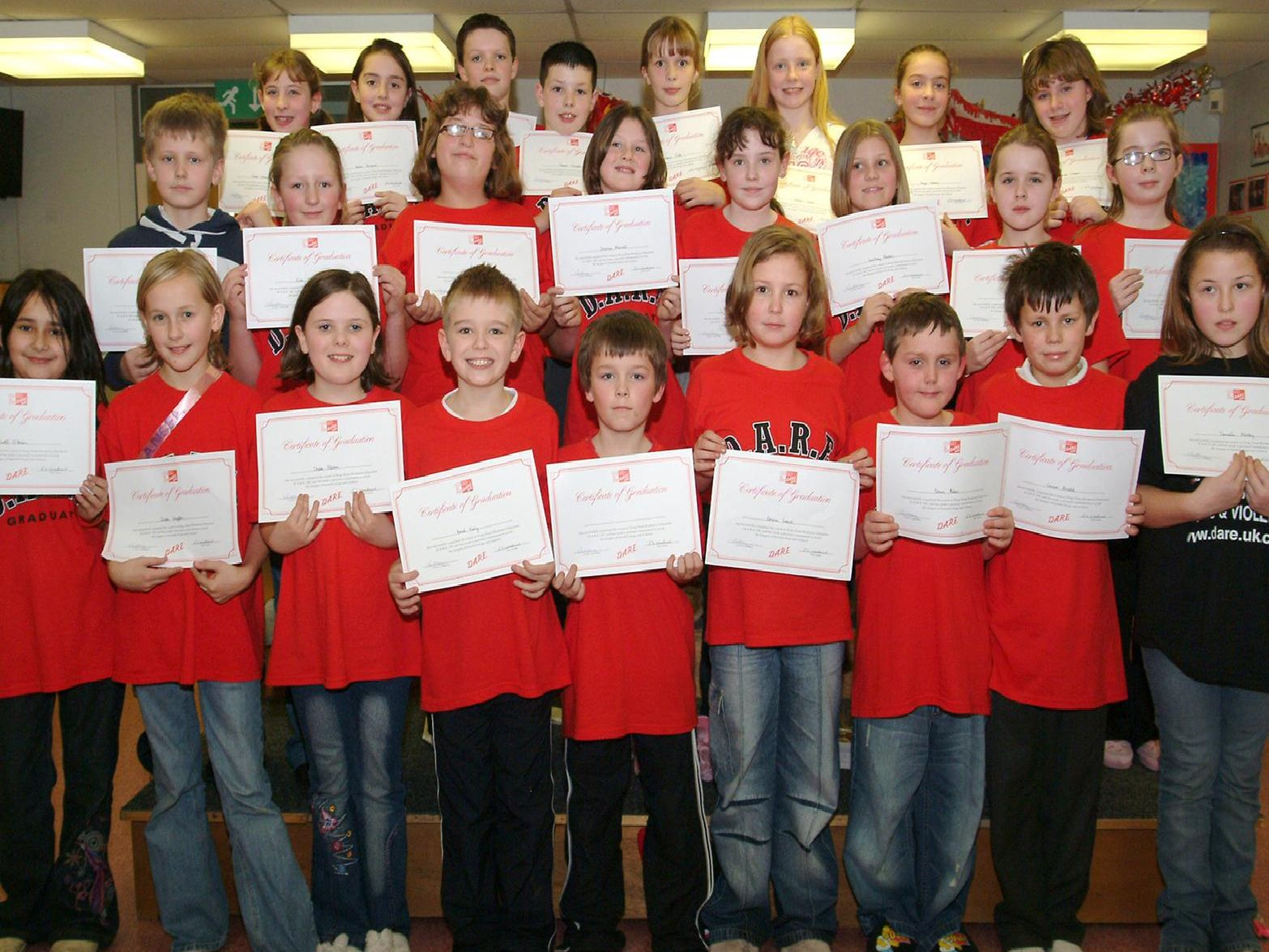 2007: Pupils from Worksop Priory School are proudly showing off their certificates during their DARE gradutaion. Are you on this picture?