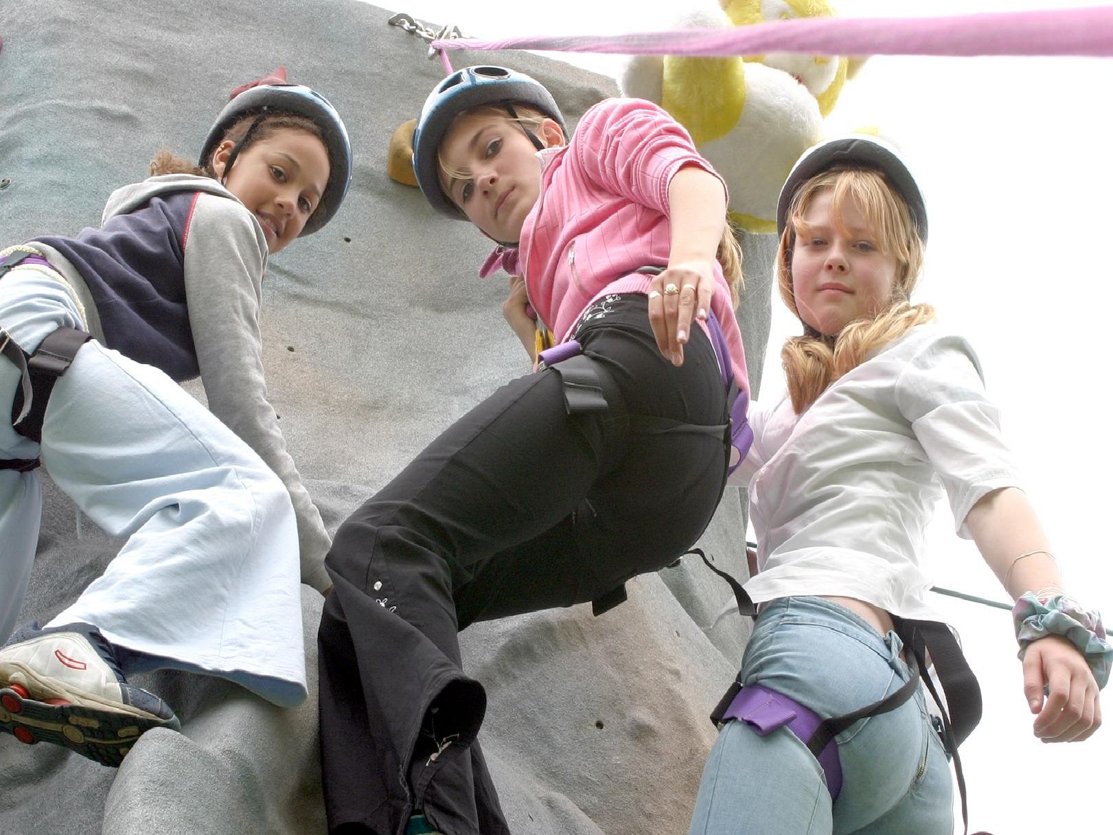 2003: These three girls are enjoying the climbing wall at Whitwell Carnival. Did you have a go at this?