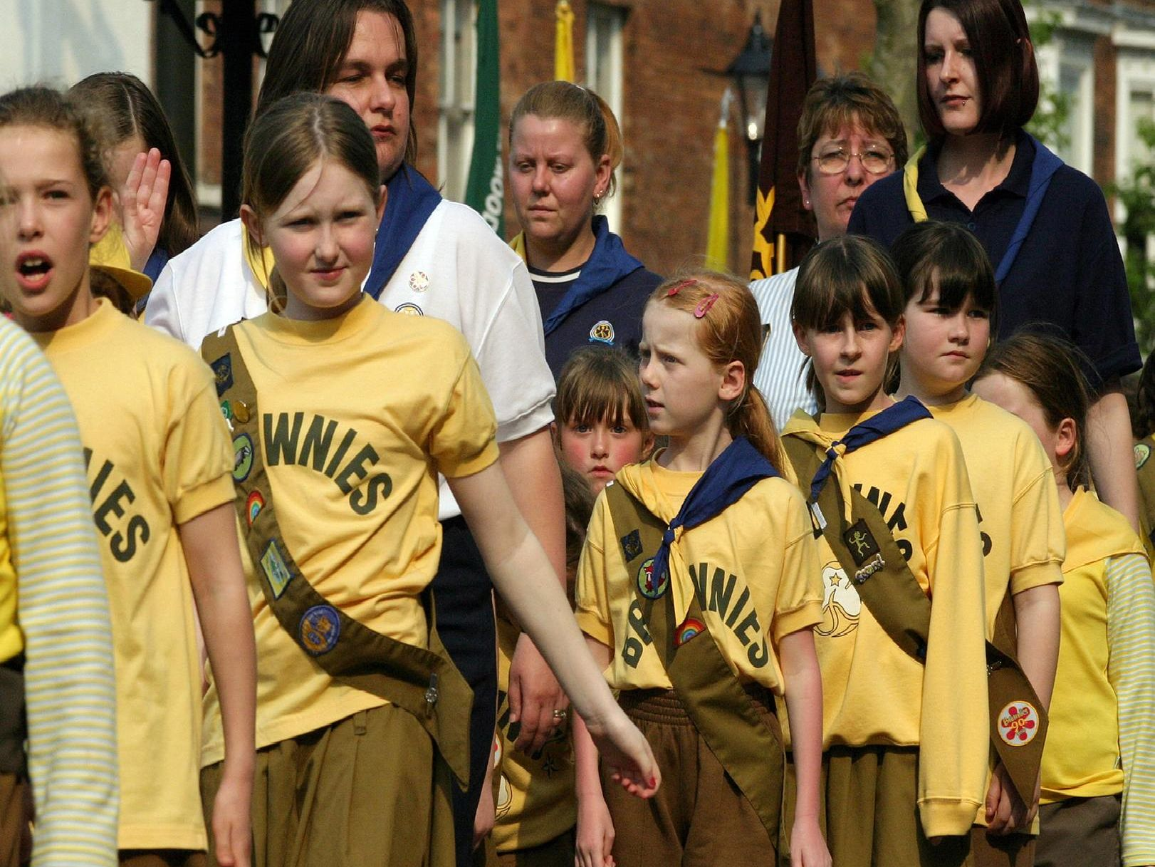 2004: A wonderful close-up of the Brownies joining in the Parade for St Georges Day. Looks like one girl is citing the Brownie Promise.