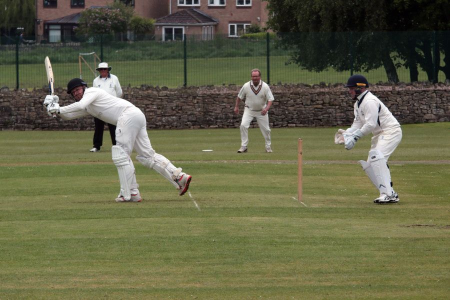 Mansfield HM batsman Stephen Gooding flicks Brandon Pritchard into the legside.