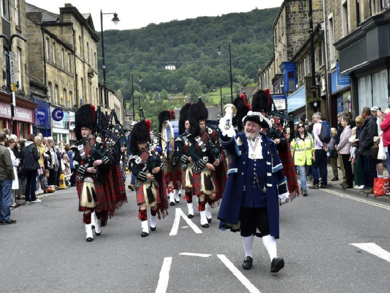 Otley bellman Terry Ford leads the parade.