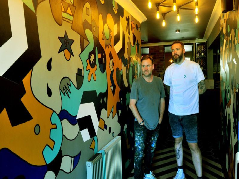 Artist Nicolas Dixon and chef Matt Healy, in the new entrance at The Beehive
