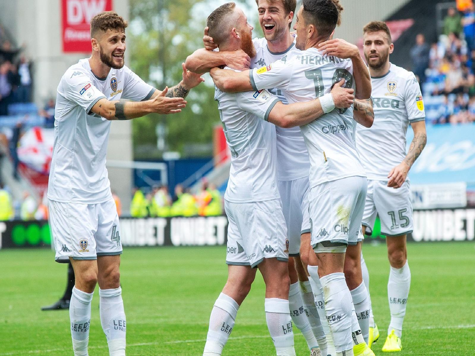 Leeds United players celebrate goal at Wigan Athletic