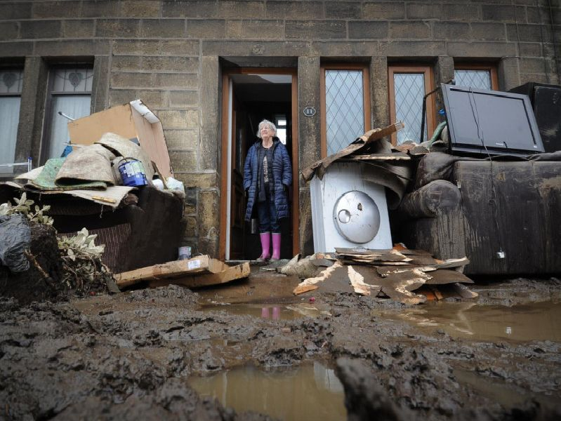 Rita Gill pictured outside her flooded property on Burnley Road, Mytholmroyd