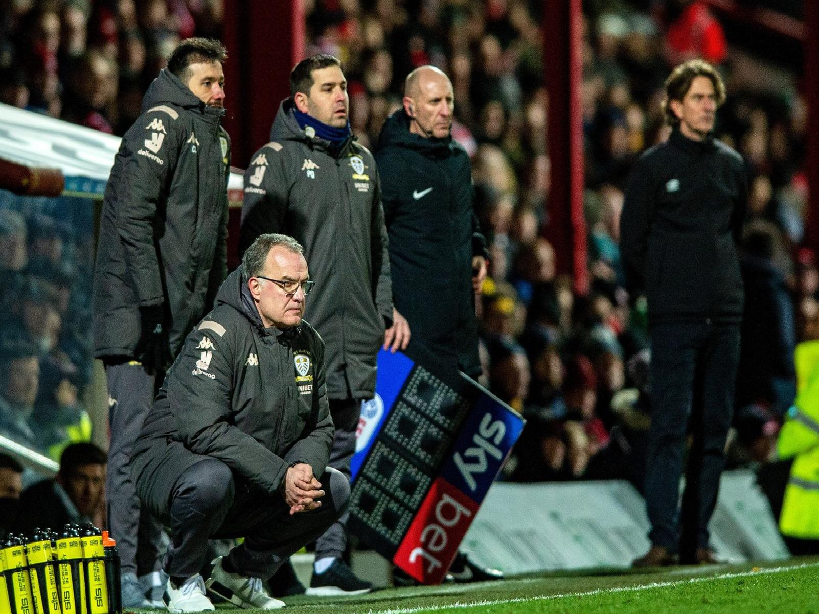 Leeds United head coach Marcelo Bielsa and his coaching staff on the touchline at Brenford