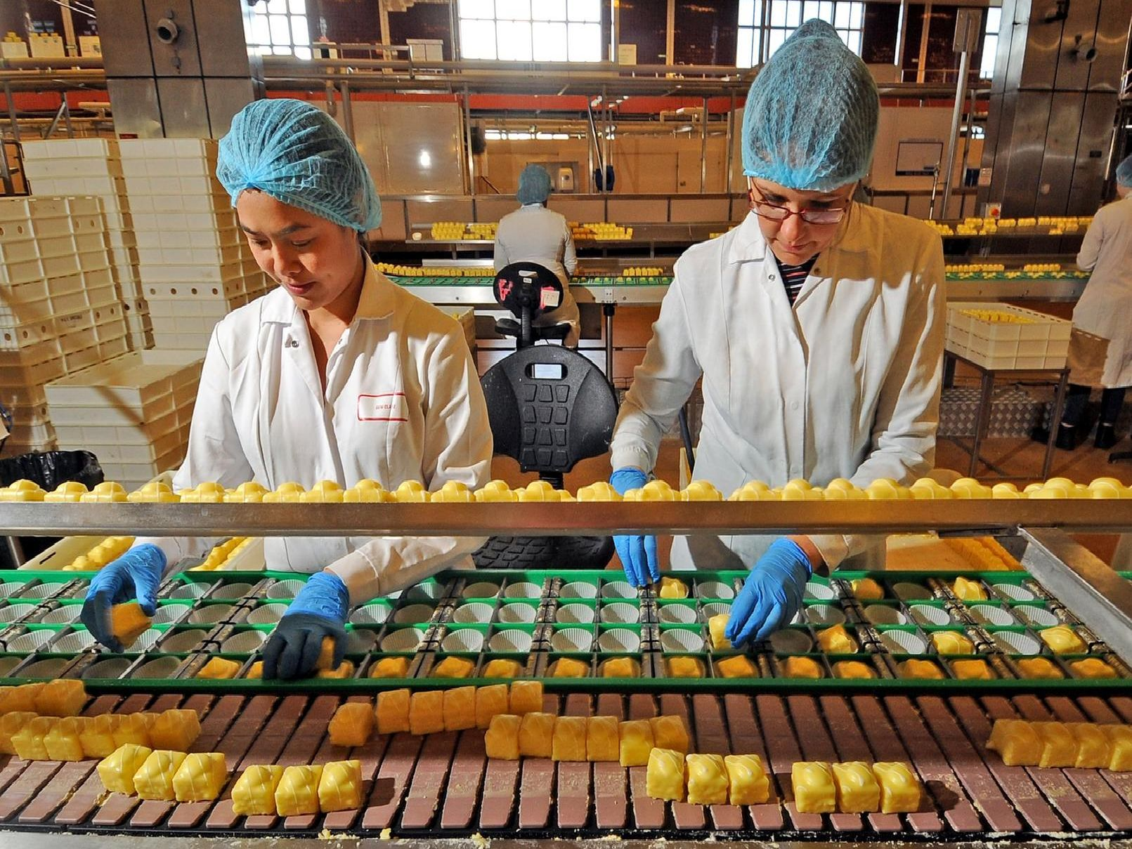 Staff at work preparing Lemon Slices