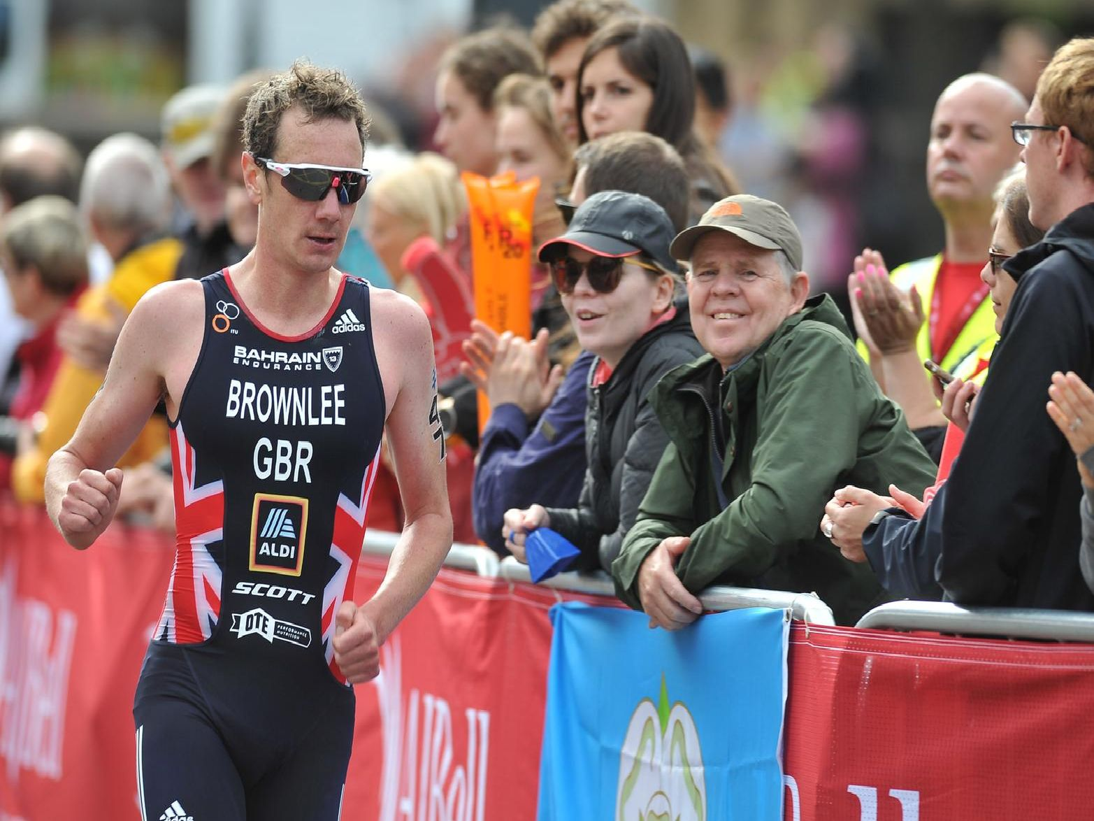 Alistair Brownlee runs past the crowds in Leeds city centre.