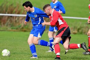 Hunsworth's captain attempts to hold off a challenge from Altofts player Josh Hetherington during his side's 14-1 hammering in West Yorkshire League Division Two last Saturday. Pictures: Paul Butterfield.
