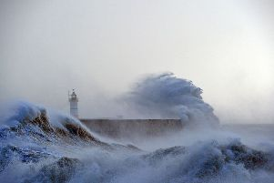 Waves crashing over Newhaven Lighthouse on the south coast of England in February 2016. Picture: GLYN KIRK/AFP via Getty Images.