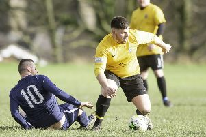 Batelians' Jak Murphy takes on St Bedes defender Andy Weatherhead during Saturday's Yorkshire Amateur League clash.