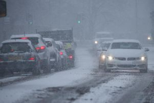 Cars navigate through the snow earlier this month. Picture by Charles Purvey.