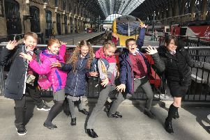Youngsters arrive in London for their big day in Parliament.