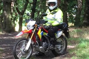 a police officer on an off-road bike
