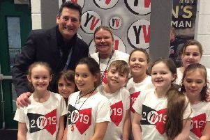 True Gent: Tony Hadley poses with Overthorpe CofE Academy pupils at the Young Voices concert.