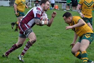 Danny Ratcliffe charges at the Hunslet Parkside defence as he looks to set up an attack during Saturday's Challenge Cup first round tie.  Picture: Dave Jewitt