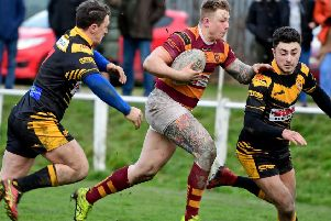 George Croisdale beats the Skirlaugh defence on the way to scoring in Dewsbury Moor's Challenge Cup first round win.