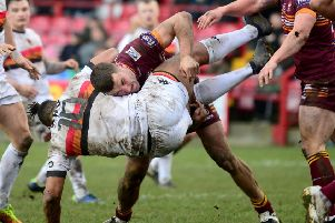 Batley's Dane Manning dumps Bradford Bulls prop Jonathan Margrin to the ground during the pre-season Yorkshire Cup Fubal between the sides at Mount Pleasant, Picture:  James Hardisty