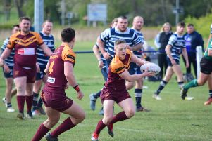Dewsbury Moor on attack during their Division One clash against Featherstone Lions. Pic: Stevan Morton