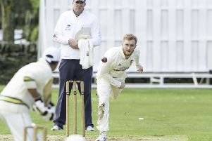 Ossett's Joe Finnigan sends down a delivery in his side's Bradford League Championship One game at East Bierley.