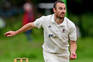 Andrew Walker claimed 4-36 for Moorlands against Honley before heavy rain saw last Saturday's Drakes Huddersfield League Premiership match abandoned. Picture: Paul Butterfield